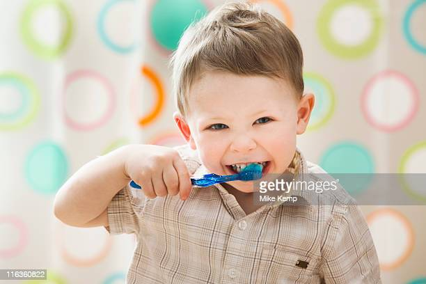 usa, utah, lehi, boy (2-3) brushing teeth - lehi stock photos and pictures