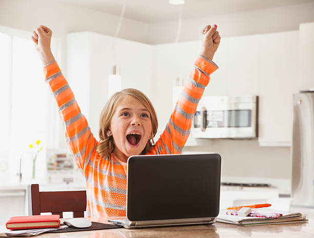 usa, utah, lehi, excited girl (6-7) with laptop - homework stock pictures, royalty-free photos & images