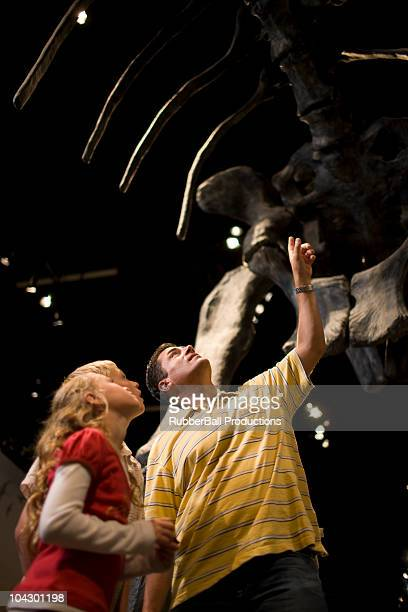 USA, Utah, Lehi, father looking at dinosaur with children (8-11) in museum