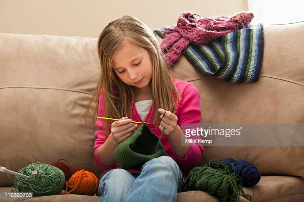 USA, Utah, Lehi, Girl (8-9) knitting woolly hat