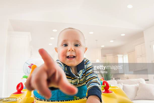 usa, utah, lehi, portrait of baby (18-23 months) pointing - baby pointing stock photos and pictures