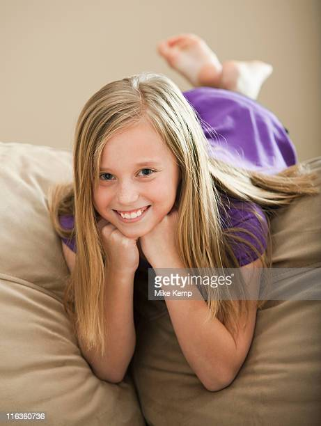 USA, Utah, Lehi, Portrait of girl (8-9) lying on sofa