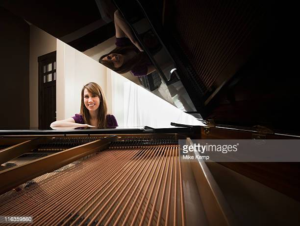 usa, utah, lehi, portrait of young pianist sitting by grand piano - pianist front stock pictures, royalty-free photos & images