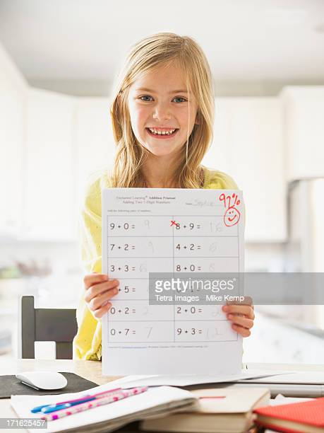 USA, Utah, Lehi, Proud girl (6-7) showing math test