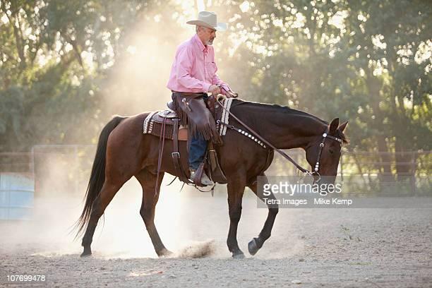 USA, Utah, Lehi, Senior man horseback riding in ranch
