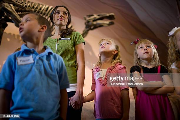 USA, Utah, Lehi, teacher with children (6-9) at museum