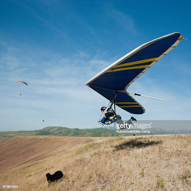 USA, Utah, Lehi, young man taking off with hang glider