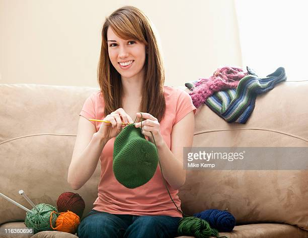 USA, Utah, Lehi, Young woman knitting woolly hat