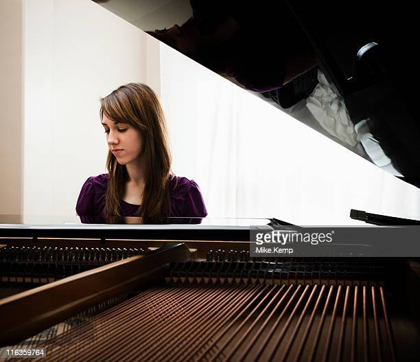 usa, utah, lehi, young woman playing grand piano - grand piano stock photos and pictures