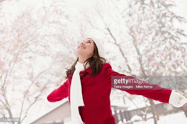 usa, utah, lehi, young woman standing in snow - red coat stock pictures, royalty-free photos & images