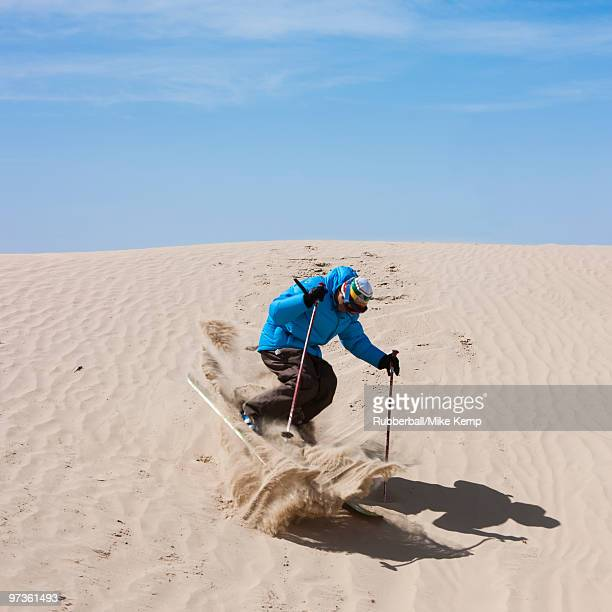 usa, utah, little sahara, man skiing in desert - sandy utah stock pictures, royalty-free photos & images