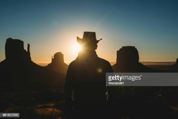 usa, utah, man with cowboy hat enjoying sunrise in monument valley - cowboy hat stock pictures, royalty-free photos & images