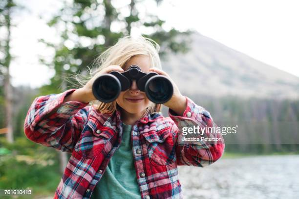 USA, Utah, Midway, Portrait of boy (6-7) looking through binoculars