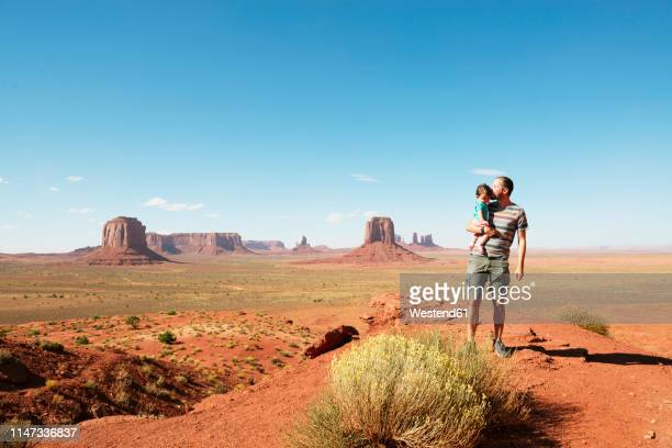 usa, utah, monument valley, father kissing his daughter on viewpoint - nature reserve stock pictures, royalty-free photos & images