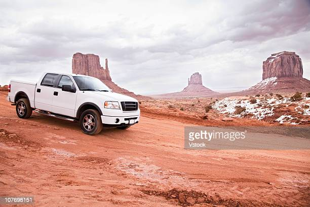 USA, Utah, Monument Valley, Truck on desert road