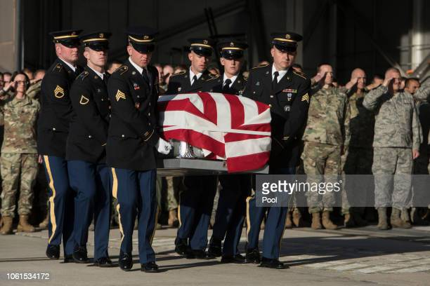 Utah National Guard Honor Guard Detail members carry a casket containing the remains of Maj Brent R Taylor at Roland Wright Air National Guard Base...