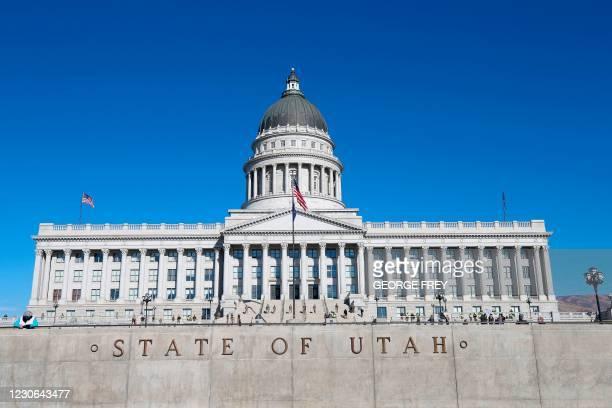 Utah National Guard troops and Utah Highway Patrol officers stand guard at the Utah State Capitol building in Salt Lake City, Utah on January 17...