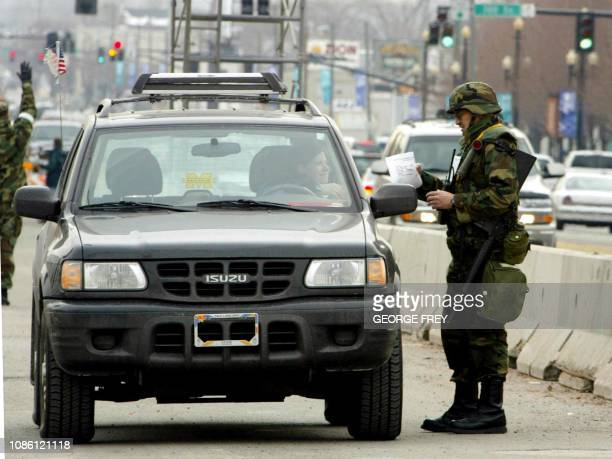Utah National Guard troops search vehicles on the street near the Main Media Center in Downtown Salt Lake City Utah 25 January 2002 Security in the...