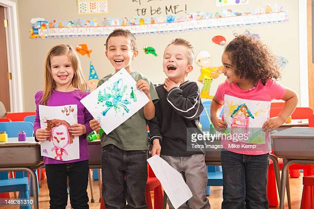 USA, Utah, Orem, Children (2-3, 4-5, 6-7) during art classes