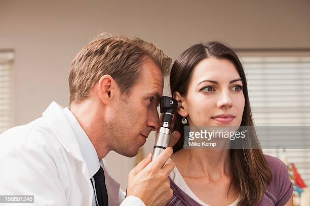 USA, Utah, Orem, Doctor performing hearing test with Otoscope
