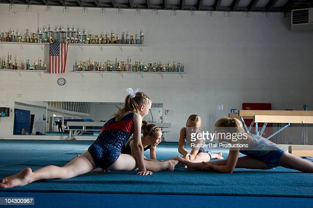 usa, utah, orem girls (8-11) stretching in gym - little girls leotards stock photos and pictures