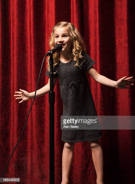 USA, Utah, Orem, Portrait of girl (8-9) singing with microphone
