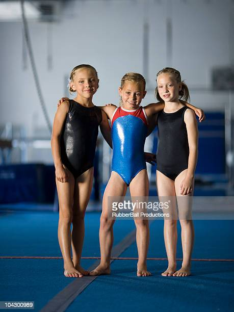 usa, utah, orem, portrait of three girls (8-9) in gym - one piece swimsuit stock pictures, royalty-free photos & images