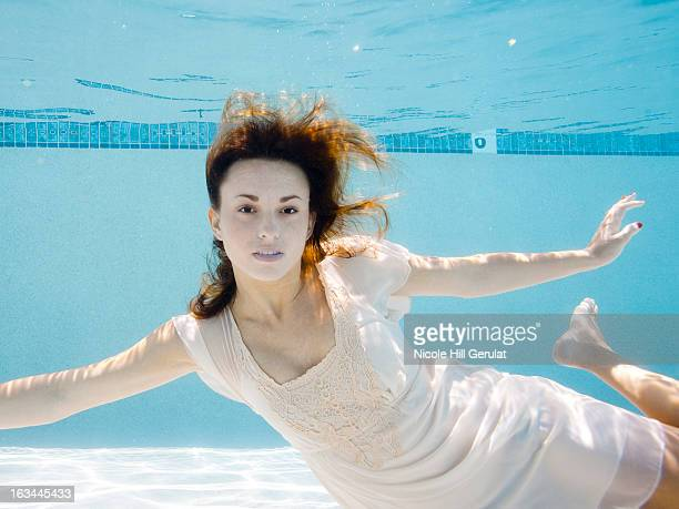 USA, Utah, Orem, Portrait of young woman under water