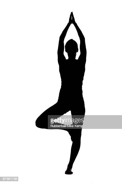 USA, Utah, Orem, Silhouette of woman standing in tree pose against white background