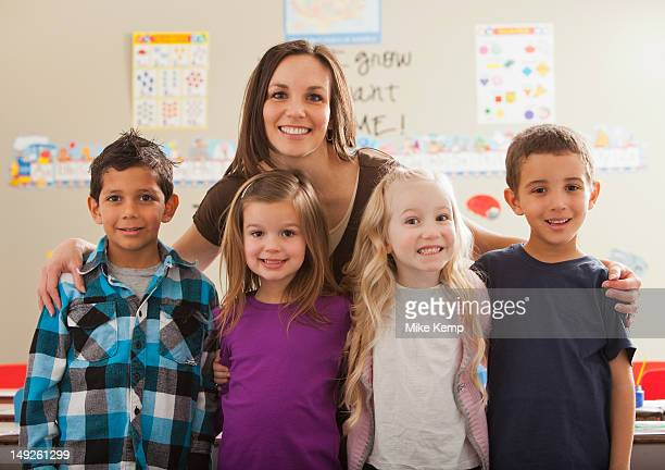 USA, Utah, Orem, Teacher with children (2-3, 4-5, 6-7) at school