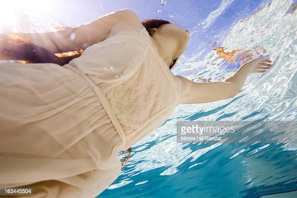 USA, Utah, Orem, Young woman in pool ballet dancing