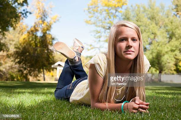 USA, Utah, outdoor of  blonde girl  (12-13) lying on grass