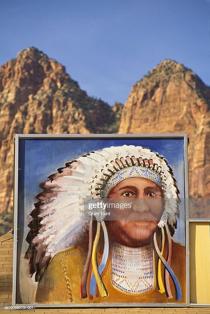 USA, Utah, painted portrait of Indian man on building in mountains : Stockfoto