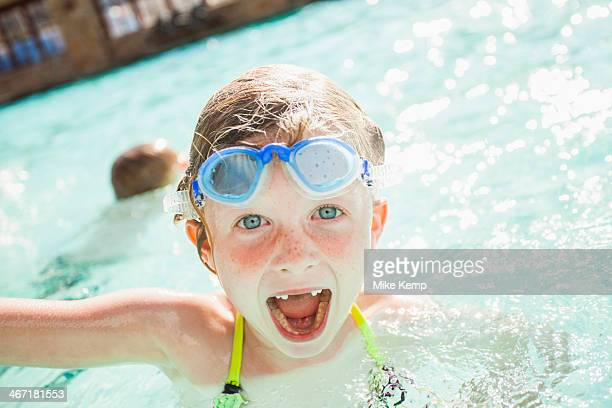 USA, Utah, Park City, Girl and boy (4-5) playing in swimming pool