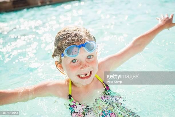 USA, Utah, Park City, Girl (4-5) playing in swimming pool