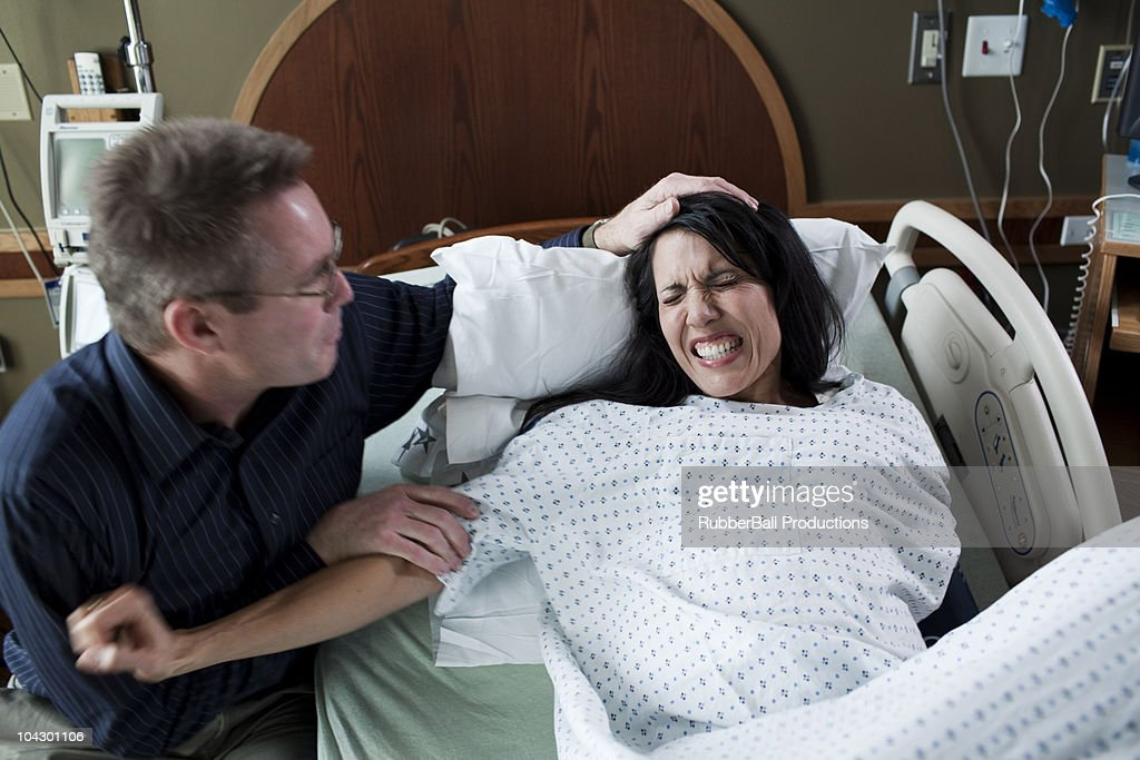 USA, Utah, Payson, Man watching wife giving birth in hospital : Stock Photo