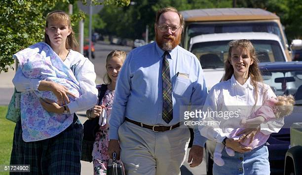 Utah polygamist Tom Green arrives at the Fourth District Court in Provo Utah 27 June 2001 with his wives and children From L to R wife LeeAnn...
