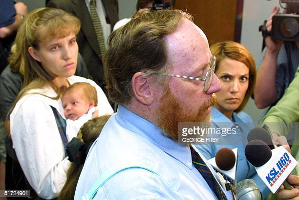 Utah polygamist Tom Green talks with reporters after a hearing in the Fourth District Court in Provo Utah 27 June 2001 as his wife LeeAnn and her...