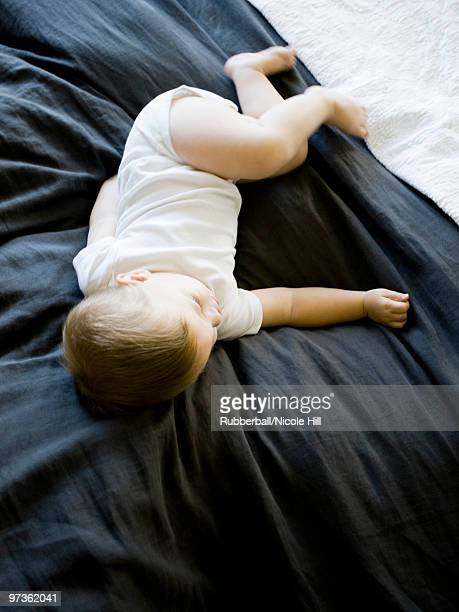 usa, utah, provo, baby boy (18-23 months) asleep on bed - 18 23 months stock pictures, royalty-free photos & images