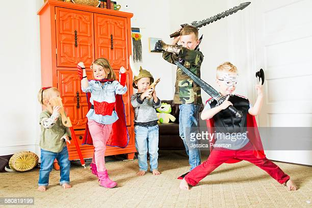 USA, Utah, Provo, Children (2-3, 4-5, 6-7) wearing superhero costumes playing at home