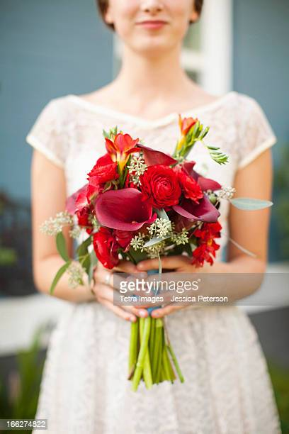 usa, utah, provo, mid section of bride with bouquet in focus - utah wedding stock pictures, royalty-free photos & images