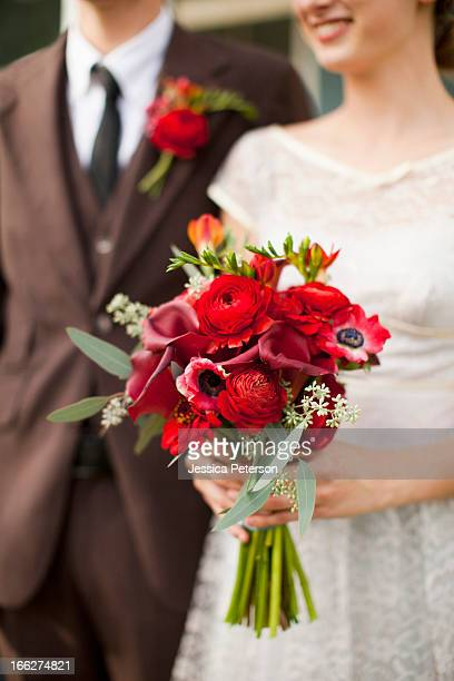 usa, utah, provo, mid section of wedding couple with bouquet in focus - utah wedding stock pictures, royalty-free photos & images