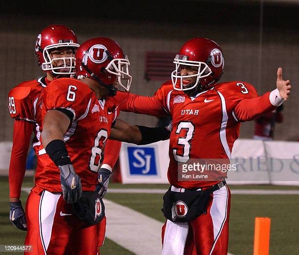 Utah quarterback Brian Johnson opens his arms wide as he gets set to hug Brent Casteel after completing a 41 yard touchdown pass at the end of the...