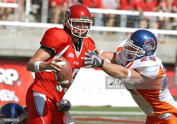 Utah quarterback is in the Brett Ratliff Boise State defender Colt Brooks, and is rushed by Korey Hall at Rice Eccles Stadium in Salt Lake City,...