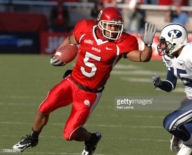 Utah receiver Brent Casteel stiff arms BYUs Justin Robinson at Rice-Eccles Stadium in Salt Lake City, Saturday, Nov. 25, 2006. BYU defeated Utah...