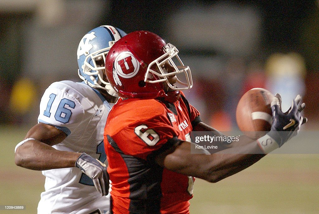 Utah receiver Steve Savoy (6) catches a 46 yard touchdown pass thrown by Alex Smith during the second quarter as North Carolina defender Jacoby Watkins (16) defends on the play. Saturday, Oct. 16, 2004 at Rice-Eccles Stadium in Salt Lake City, Utah