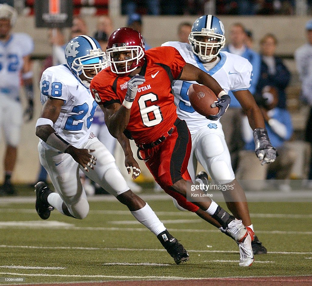 Utah receiver Steve Savoy (6) races past N. Carolina defenders D.J. Walker (28) and Quinton Person (9) for a 23 yard pass reception during the first quarter Saturday, Oct. 16, 2004 at Rice-Eccles Stadium in Salt Lake City, Utah