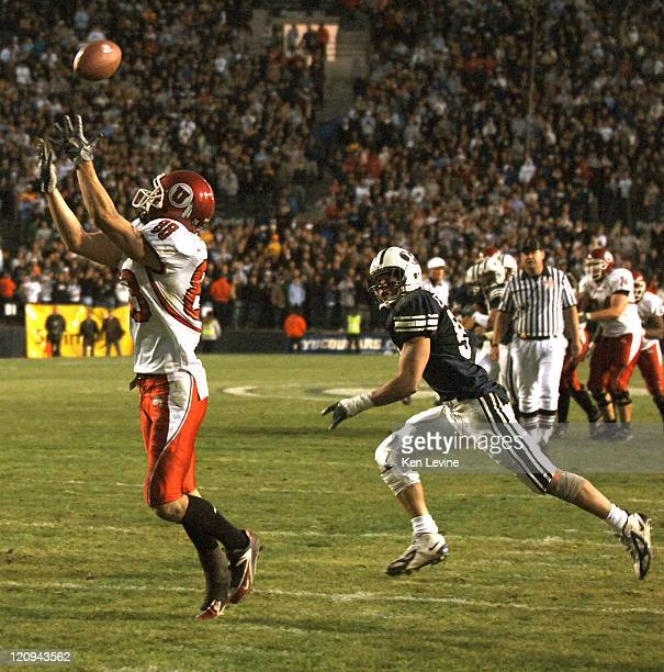 Utah receiver Travis LaTendresse makes a leaping catch on a 25 yard touchdown pass thrown by Utah quarterback Brett Ratliff in the first overtime to...