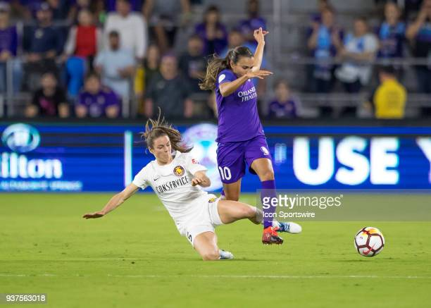 Utah Royals FC defender Kelley O'Hara clears Orlando Pride forward Marta from possessing the ball during the NWSL soccer match between the Orlando...