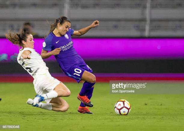 Utah Royals FC defender Kelley O'Hara slides tackles Orlando Pride forward Marta during the NWSL soccer match between the Orlando Pride and the Utah...